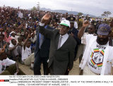 ZIMBABWEAN PRESIDENT ROBERT MUGABE,CENTER , WAVE AT THE CROWD DURING A RALLY IN GOOR