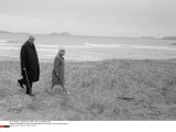IRERLAND: De Gaulle & his wife walking on the beach near Derrishame House