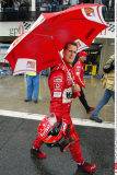 Ferrari's Michael Schumacher of Germany walks in the rain down the pit lane back to his garage after leaving his car at race control during the first qualifying session at the Canadian Grand Prix in Montreal Friday, June 13, 2003. (AP PHOTO/Paul Chias/SIP