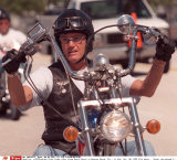 **FILE**Actor Peter Fonda rides along Beach Street in Daytona Beach, Fla., in this  Oct. 20, 1999 file photo..  Fonda, who played Captain America in the 1969 biker film, ``Easy Rider,'' is in New Hampshire for Bike Week in Laconia and will be the gran/SIP