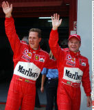 Ferrari drivers Michael Schumacher of Germany, left and Rubens Barrichello of Brazil wave after Schumacher clocked to fastest time to win pole position with Barrichello clocking second fastest time after qualifying practice for Sunday's Formula 1 Span/SIP