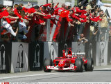 Germany's Michael Schumacher of Team Ferrari clinches the fist after crossing the finish line in first position celebrated by his team during the Austrian Formula One Grand Prix in Spielberg, Austria, on Sunday, May 18, 2003. Schumacher won ahead of F/SIP