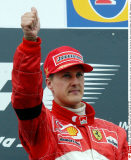 Germany's Michael Schumacher gives the thumb up sign to his fans after taking his Ferrari to victory in the F1 Grand Prix of San Marino at Imola racetrack Sunday, April 20, 2003. Schumacher wears an armband in sign of mourning for his mother Elisabeth/SIP