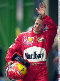 Defending world champion Ferrari's Michael Schumacher ,of Germany, waves to fans Friday, April 4, 2003  after a qualifying session at Sao Paulo's track race for Sunday's Brazil Formula One Grand Prix. (AP Photo/Fernando Llano)/F1 BRAZIL GRAND PRIX/030/SIP