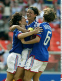 France's, from left, Marinette Pichon (9), Corinne Diacre (5) and Sandrine Soubeyrand (6) celebrate Pichon's goal in the extended time of the second half of their match against Brazil, Saturday, Sept. 27, 2003, at the 2003 Women's World Cup at RFK Sta/SIP
