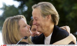 Actor-director Peter Fonda gets a hug from his daughter, actress Bridget Fonda, before he received a new star on the Hollywood Walk of Fame in Los Angeles, Wednesday, Oct. 22, 2003. (AP Photo/Chris Pizzello)/SIPA