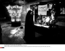 TEHRAN : A mother weeps her son dead during the war with Irak