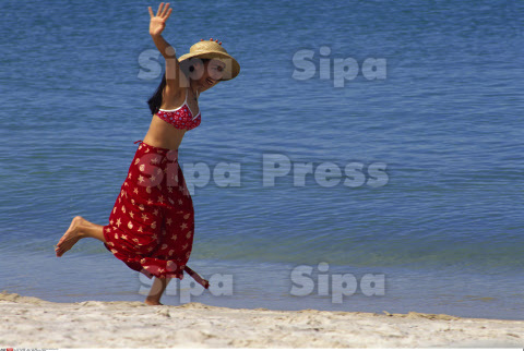 Thailand, Phuket, Woman Running on Beach